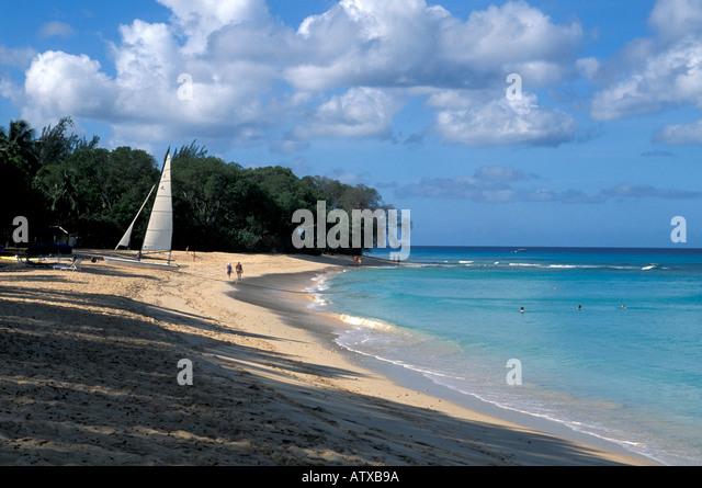 Caribbean islands Barbados beach with few people at Sandy Lane Resort - Stock Image