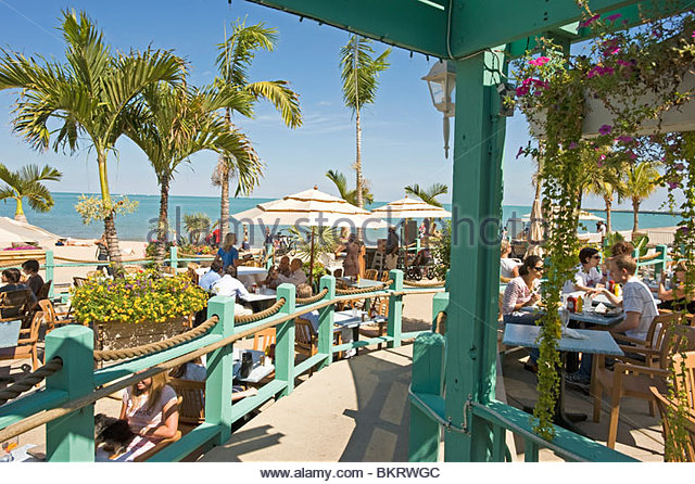 One of the in places to hang out on a sunny day is the Oak Street Beach Restaurant on Oak street beach. Chicago,Illinois,Usa - Stock Image