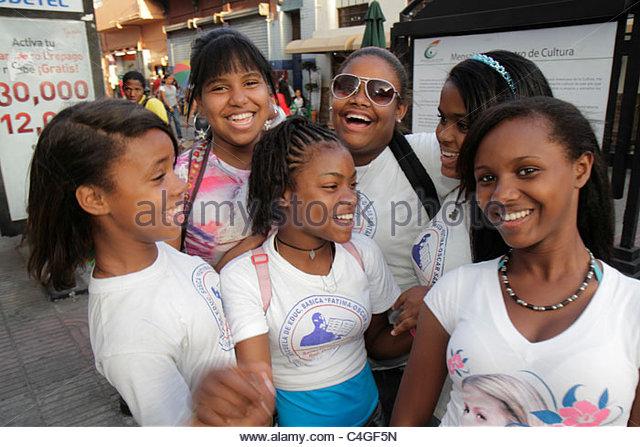 Santo Domingo Dominican Republic Ciudad Colonial Calle el Conde Peatonal pedestrian mall Black student girl teen - Stock Image