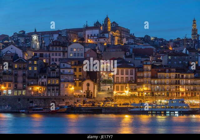 Dusk over the Ribeira waterfront in the city of Porto (Oporto) in Portugal. - Stock Image