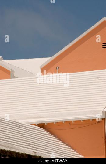 Bermuda pink buildings Hamilton white ribbed roofs iconic bermudan symbol image - Stock Image