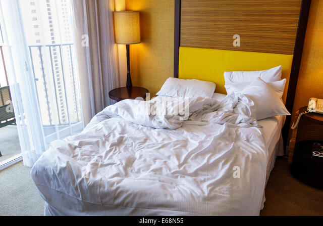 Hawaii Hawaiian Honolulu Waikiki Beach resort Hilton Waikiki Beach hotel guest room unmade bed - Stock Image
