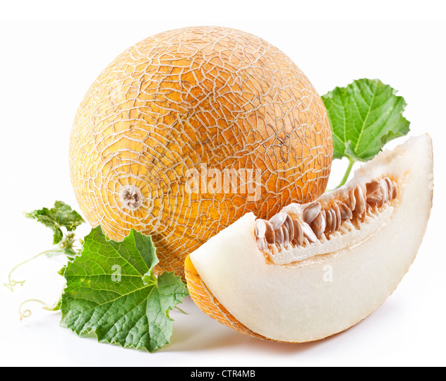 Melon with slices and leaves on a white background. - Stock Image