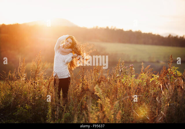 Outdoor portrait of beautiful woman in autumn meadow - Stock Image