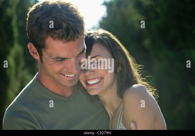 Happy couple outdoors - Stock Image