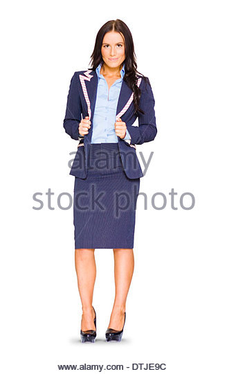 Full Body Isolated Studio Portrait Of A Smiling Female Business Woman Holding Jacket On Pin Striped Suit In A Stance - Stock Image