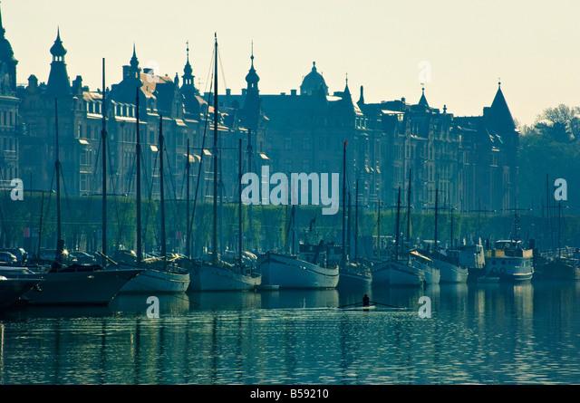 Early morning sculler passing Strandvägen Stockholm Sweden - Stock Image