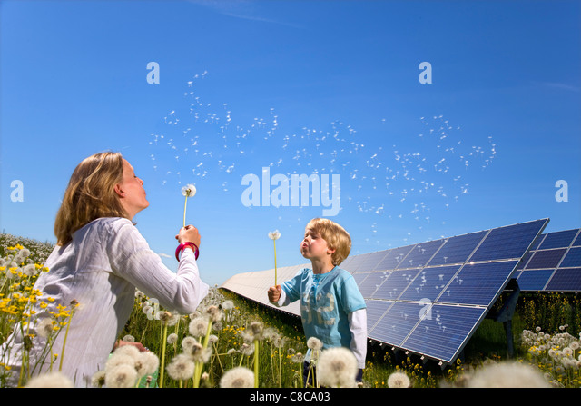 Mother and son with solar panels - Stock Image
