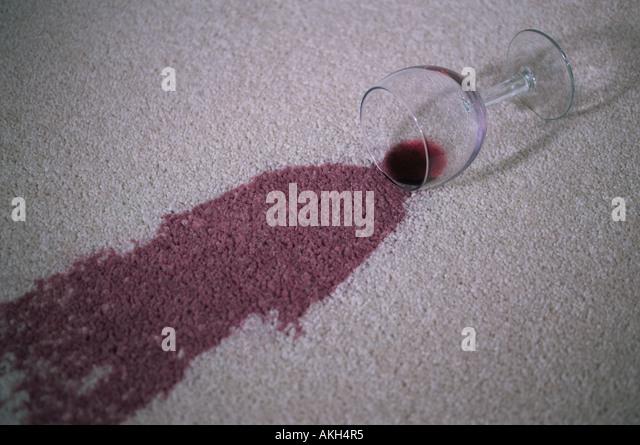 Red wine stain on a carpet - Stock-Bilder