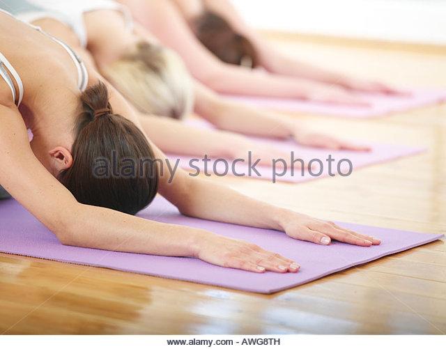 Three women doing pilates - Stock Image