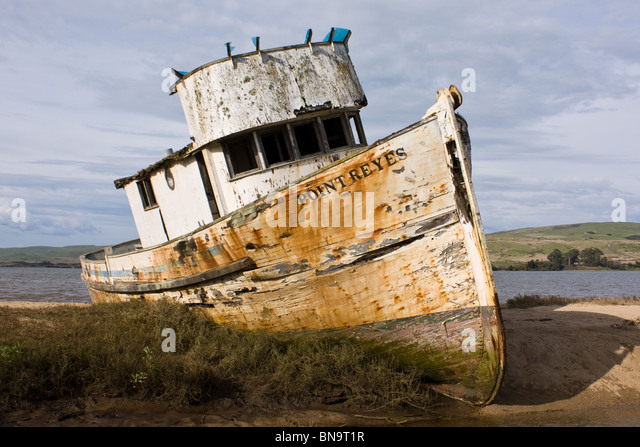 rustic and battered, the boat Pt Reyes has stood aground for several decades creating a classic setting - Stock-Bilder