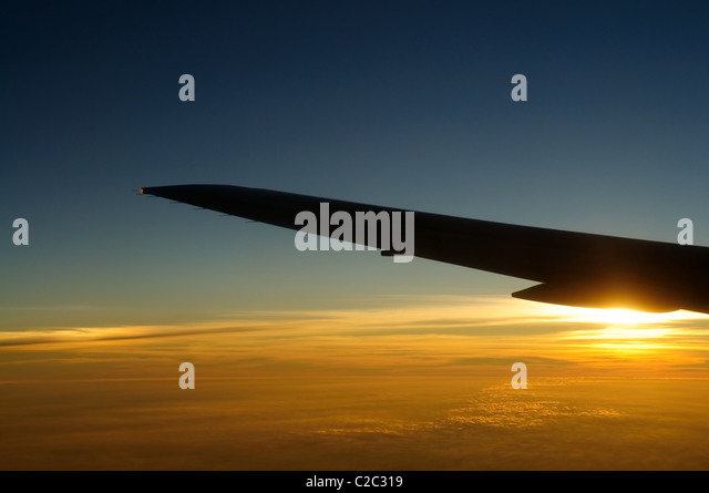 Sunset under airplane wing skyline - Stock Image