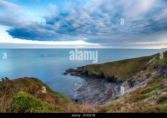 Clouds gather over Gribbin Head near St Austell in Cornwall - Stock Image
