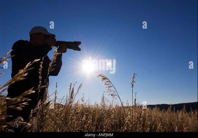 Silhouette of photographer, British Columbia, Canada. - Stock Image