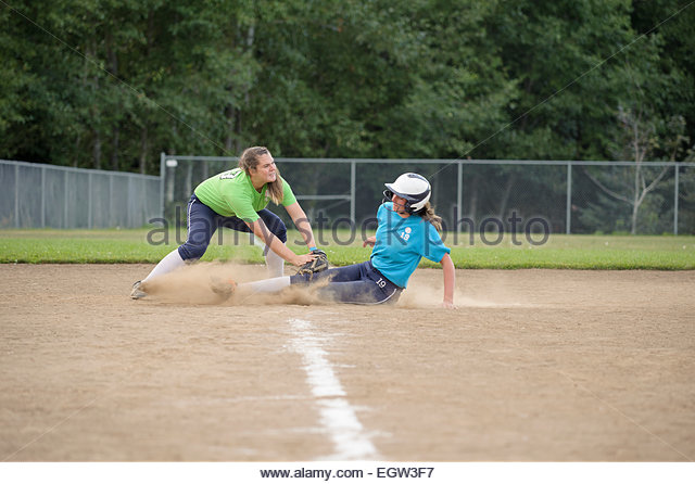Teenager getting tagged at base. - Stock Image