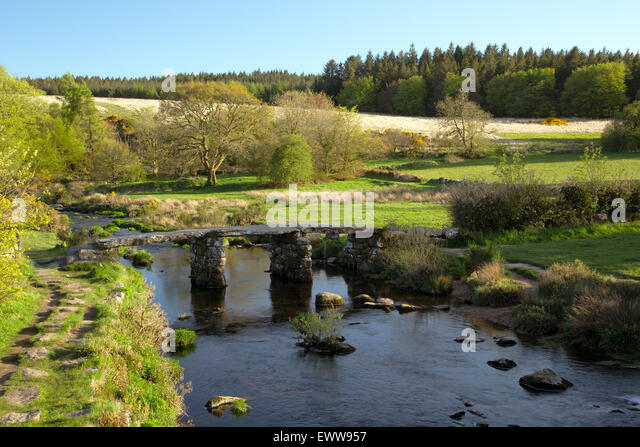 Stone clapper bridge over the East Dart at Postbridge Dartmoor National Park - Stock Image