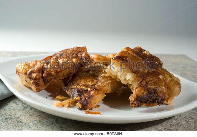 Pork rind cracklings - Stock Image