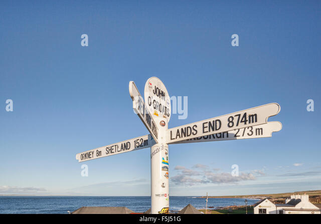 Signpost at John o' Groats, the furthest north-east inhabited point of mainland Britain. - Stock Image
