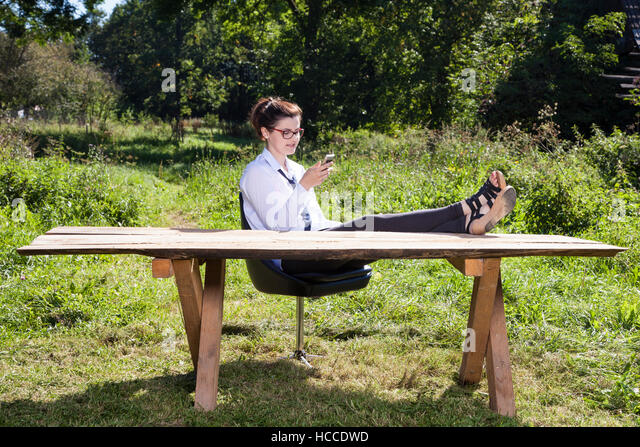business woman taking a rest from everyday life - Stock-Bilder