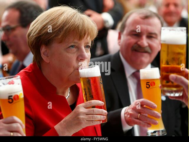 Ingolstadt, Germany. 22nd Apr, 2016. German chancellor drinks beer as she participates in a ceremony celebrating - Stock Image