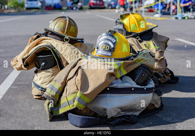 Stacked fireman's emergency turn out gear. - Stock Image