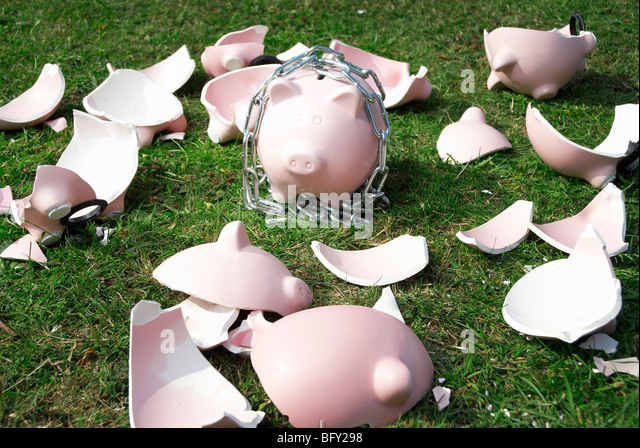 piggy bank in chains - Stock Image