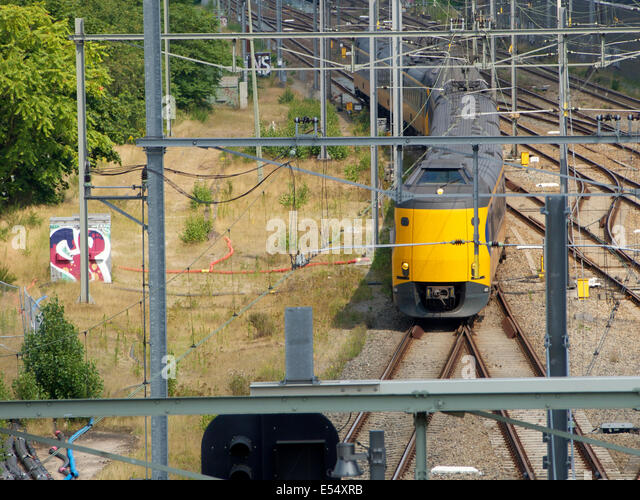 Dutch koploper-type intercity train near station Breda, the Netherlands - Stock-Bilder