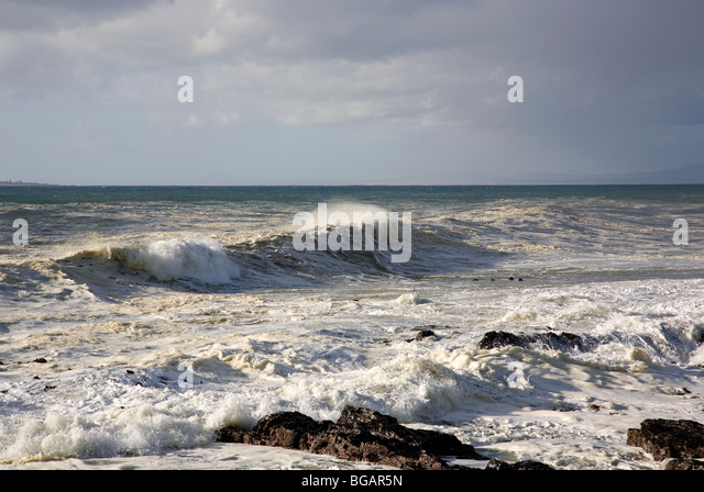 Frothy waves in Sea Point, Cape Town - Stock Image
