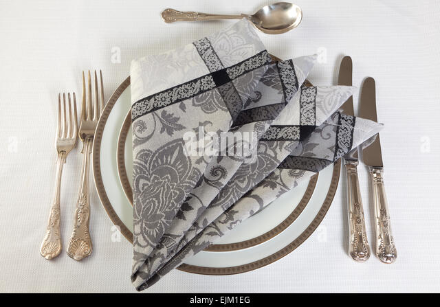 Antique silver cutlery and artistically folded napkins - Stock-Bilder