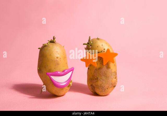 a pop and minimal potato portrait on a pink background - Stock Image