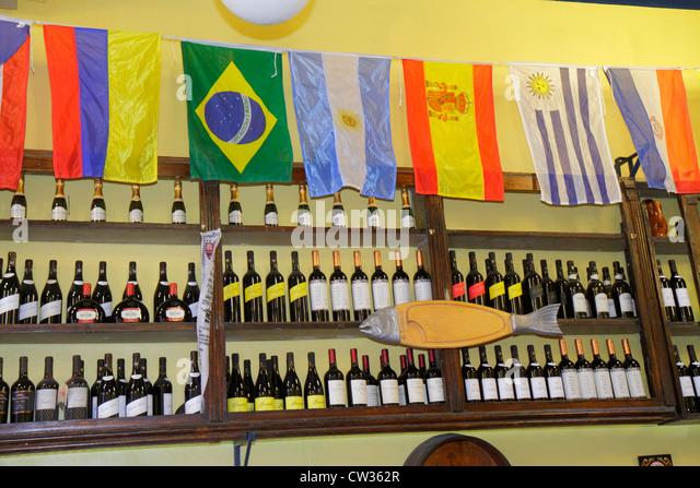 Argentina Buenos Aires San Telmo Avenida Defensa wine shop business bottle flags shelf display - Stock Image