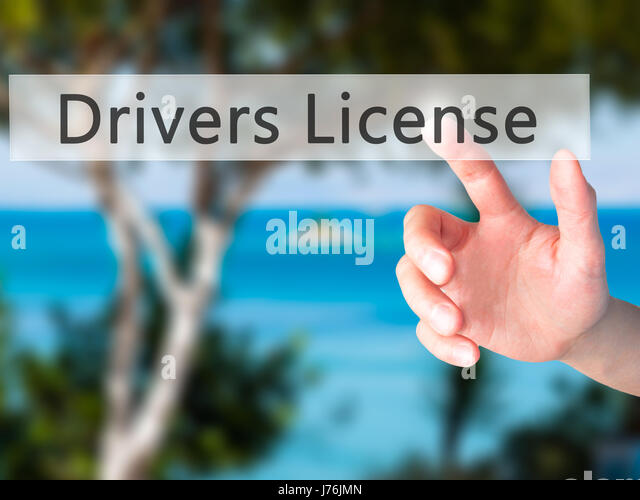 Drivers License - Hand pressing a button on blurred background concept . Business, technology, internet concept. - Stock Image
