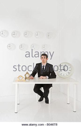 Man with clocks - Stock Image
