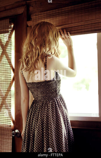 Woman at window - Stock Image