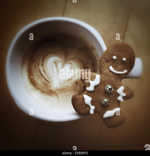 Holiday season - gingerbread cookie & latte - Stock-Bilder
