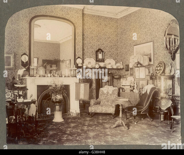 A Victorian sitting room           Date: circa 1900 - Stock Image