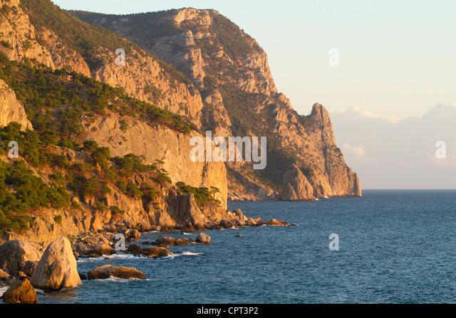 Beautiful mountain seaside at sunset - Stock Image