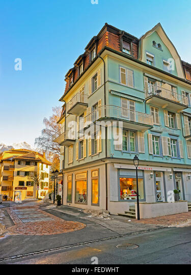 BAD RAGAZ - JANUARY 1, 2014: Houses and the Alps. Bad Ragaz is a city in canton St. Gallen in Switzerland.  It lies - Stock Image