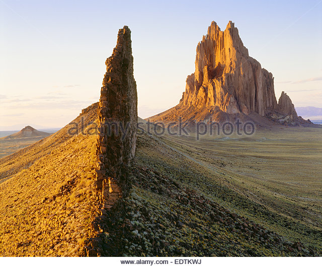 Shiprock, 1100 foot high volcanic monolith, with connected volcanic dike.  Navajo Indian Reservation, New Mexico. - Stock Image