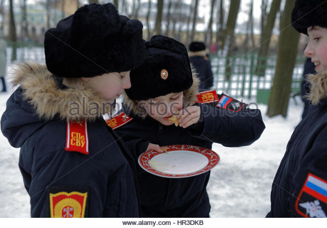 St. Petersburg, Russia, 26th February, 2017. Cadets of Suvorov military school eating blinis during Shrovetide celebrations - Stock Image