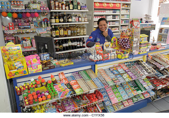 Cancun Mexico Yucatán Peninsula Quintana Roo Beach Hotel Zone Avenida Kukulkan Hispanic woman employee cashier - Stock Image