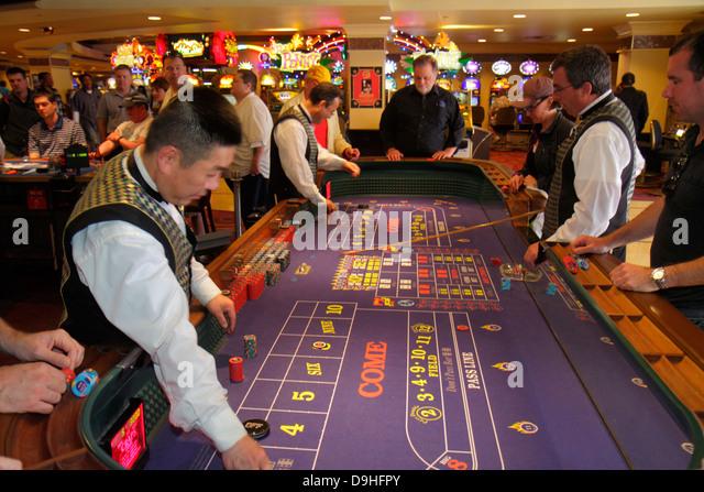 Nevada Las Vegas The Strip South Las Vegas Boulevard Harrah's Las Vegas Hotel casino gambler gambling craps - Stock Image