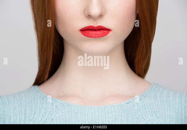 Cropped image of young woman's lips - Stock-Bilder
