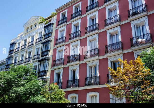Spain Europe Spanish Madrid Salamanca Recoletos Calle Pedro Munoz Seca building apartment flats balcony wrought - Stock Image