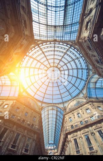 Sun shining through ornate glass ceiling - Stock Image