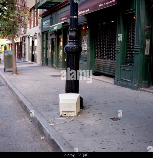 USA, New York State, New York City, Old monitor left on street - Stock Image
