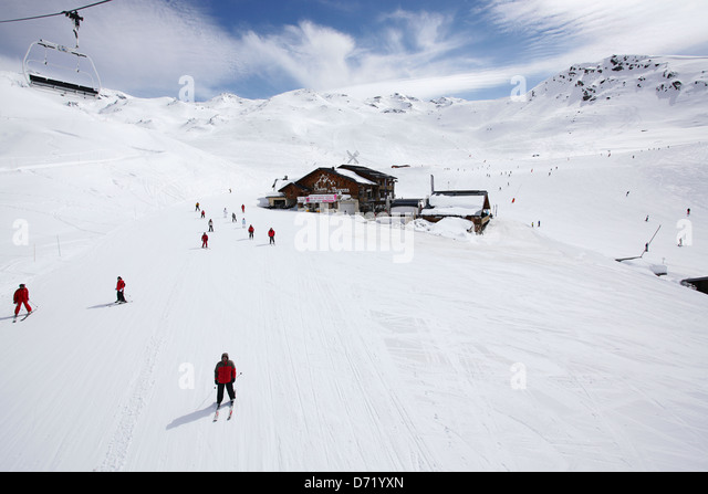 Les Chalets du Thorens with skiers in the foreground & background. Travel type photo from a skiing holiday in - Stock-Bilder