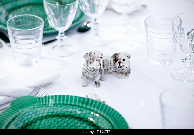 Dog figurines on table - Stock Image