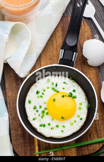 Fried egg made in a small pan - Stock Image