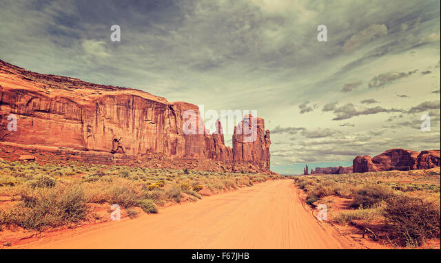 Vintage style photo of sandy road in Monument Valley, Utah, USA. - Stock Image